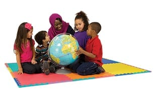 Diverse children sitting holding a globe - about