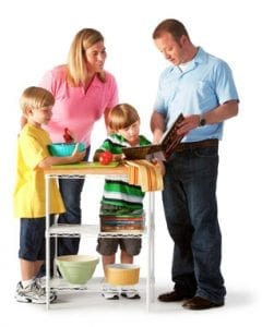 Family preparing food reading recipe - about