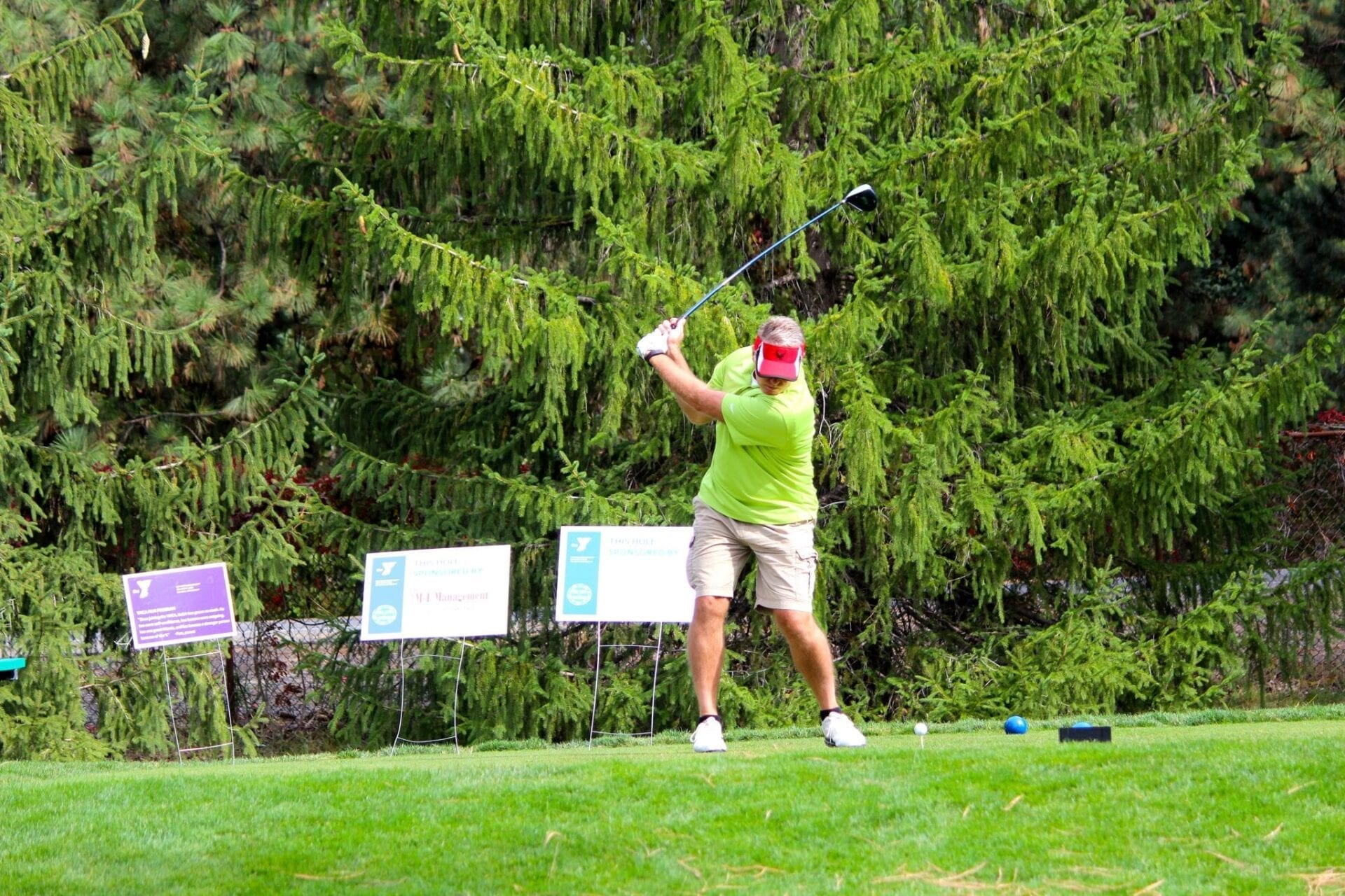 Tee Off For Teens golfer swinging at ball