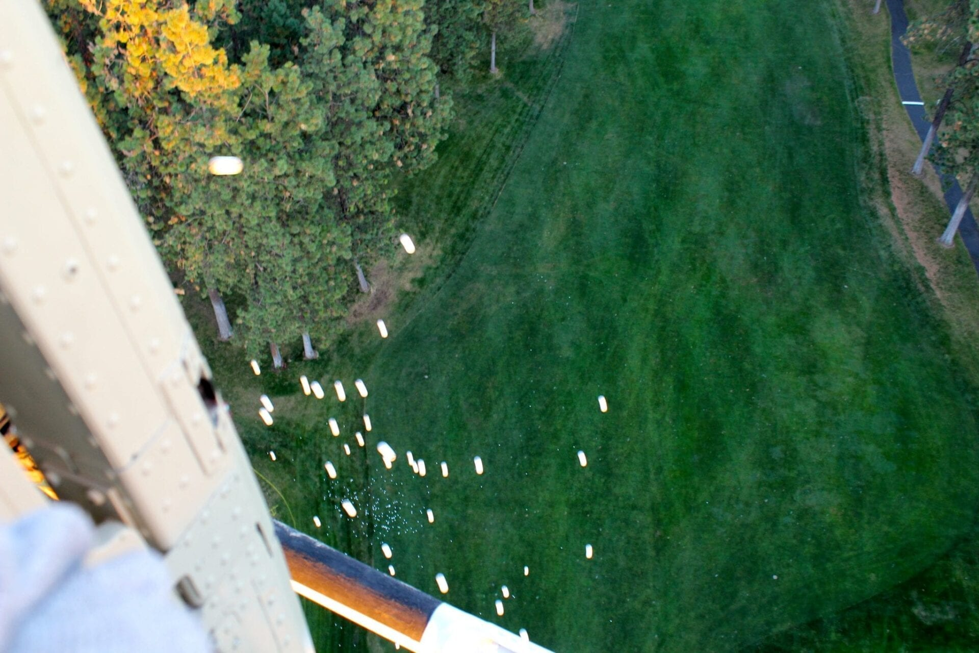 Golf balls drop from helicopter to the 18th green