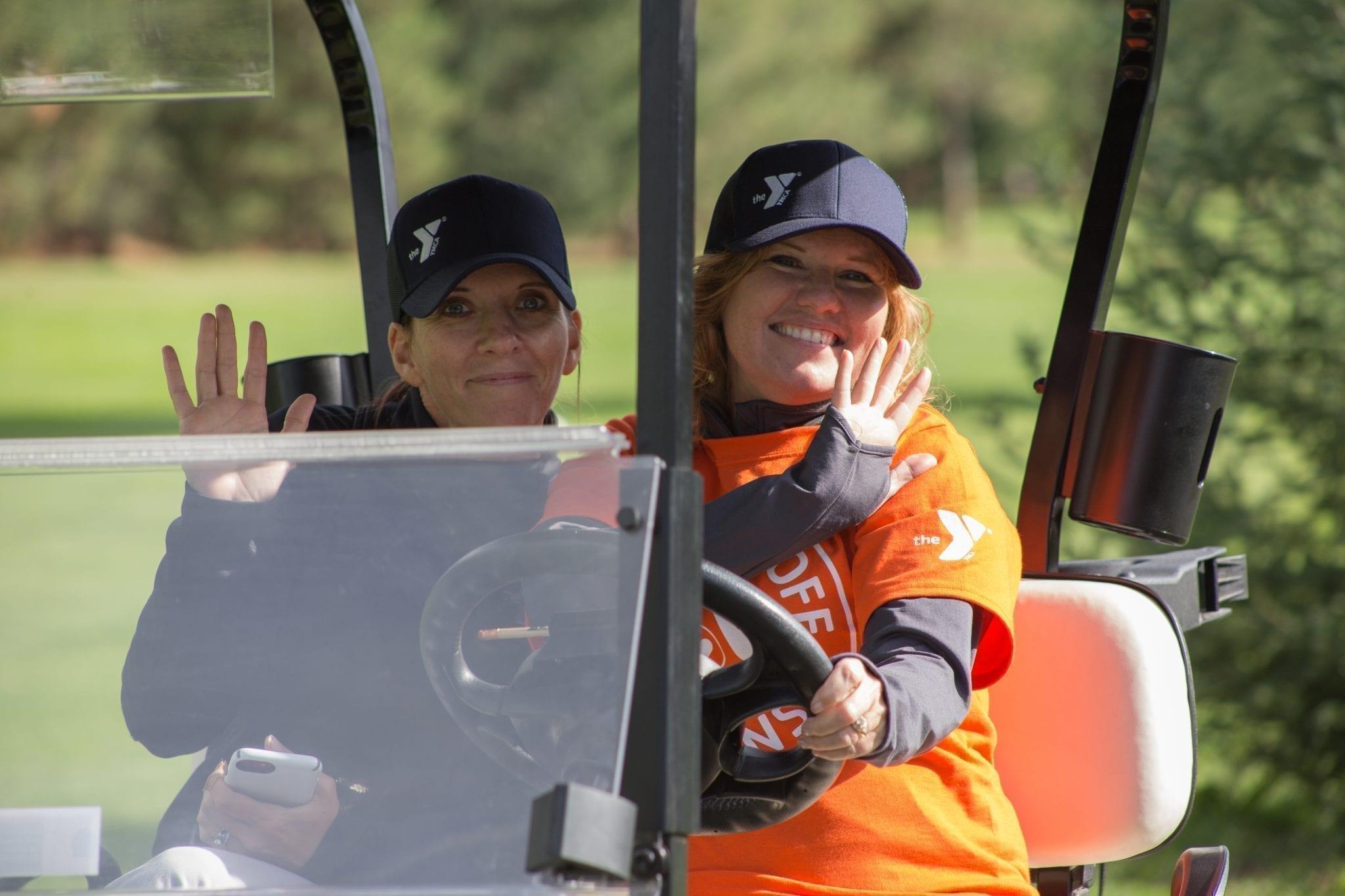 Tee Off For Teens Volunteers in golf cart