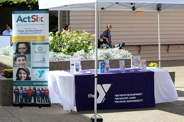 YMCA Act Six table at Tee Off For Teens golf tournaments