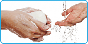 Washing Hands Hands holding soap under running water